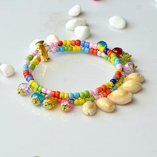 Two-strand Spiral Shell Bead Pendant Bracelet